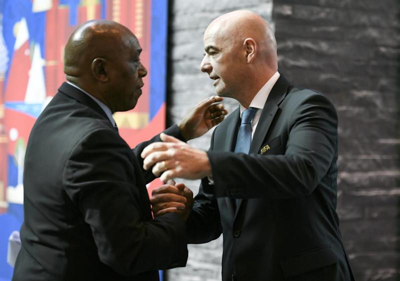 Tokyo Sexwale, left, with FIFA president Gianni Infantino.