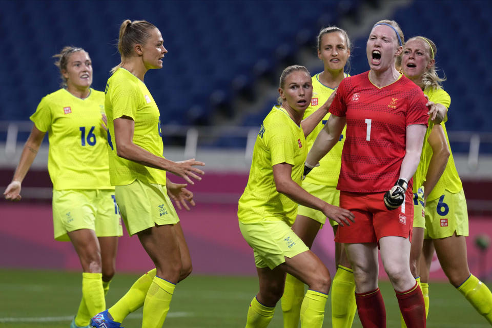 Sweden's goalkeeper Hedvig Lindahl (1) reacts as she celebrates with her teammates after stopping a penalty kick by Australia during a women's soccer match at the 2020 Summer Olympics, Saturday, July 24, 2021, in Saitama, Japan. (AP Photo/Martin Mejia)