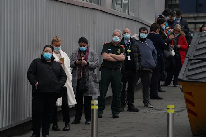 People queue outside the NHS vaccine centre that has been set up at the Centre for Life in Times Square, Newcastle. The centre is one of the seven mass vaccination centres now opened to the general public as the government continues to ramp up the vaccination programme against Covid-19.