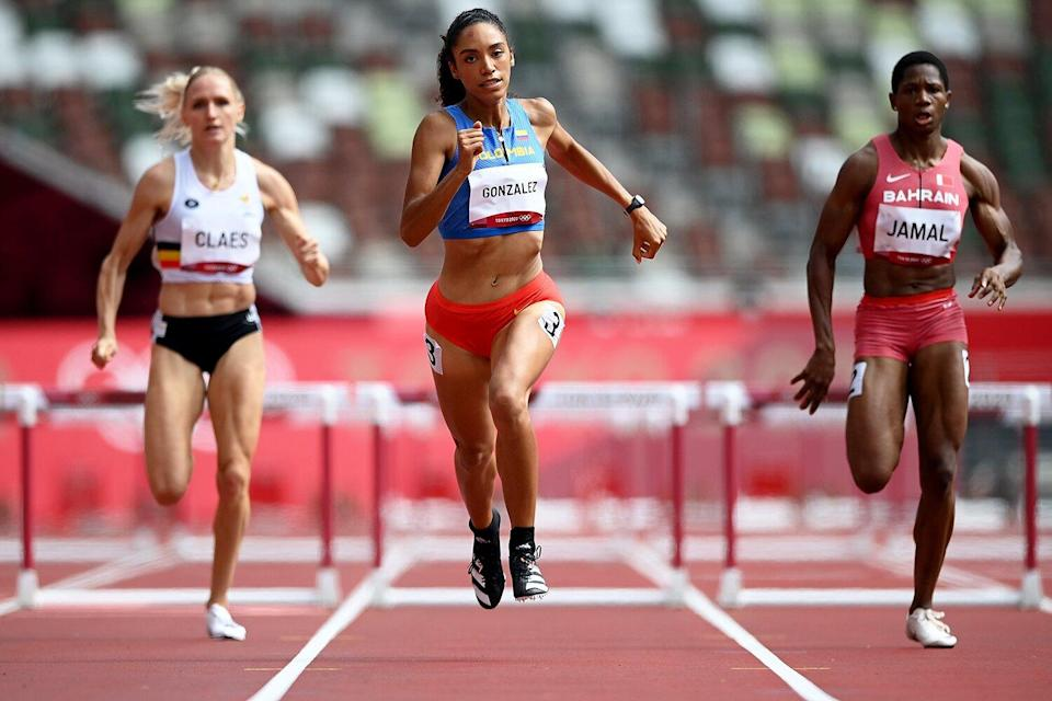 Melissa Gonzalez (C) of Team Colombia competes in round one of the Women's 400m hurdles heats on day eight of the Tokyo 2020 Olympic Games at Olympic Stadium on July 31, 2021 in Tokyo, Japan.