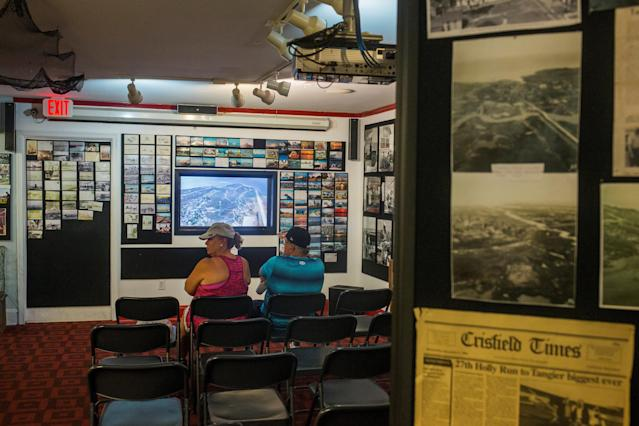 <p>Visitors watch a short film at the Tangier History Museum on Tangier Island, Virginia, Aug. 2, 2017. (Photo: Adrees Latif/Reuters) </p>