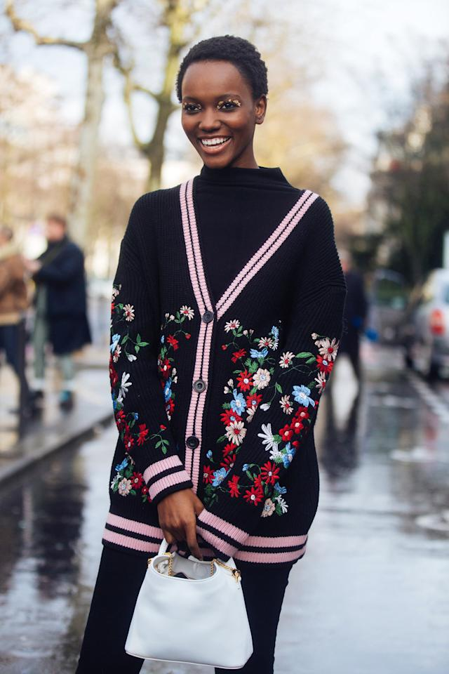 <p>Layer up, not only wearing your cardigan as a dress, but also layerimg it over a slim turtleneck and tights.</p>