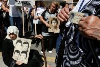 FILE PHOTO: Women hold pictures of relatives who went missing during Lebanon's civil war during a protest in Beirut
