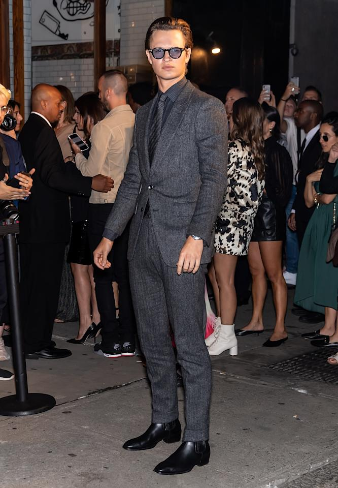 <p>WHAT: Tom Ford</p> <p>WHERE: At the Tom Ford show during New York Fashion Week</p> <p>WHEN: September 9, 2019</p> <p>WHY: Ansel Elgort, cutting the ribbon on suits-and-boots weather.</p>