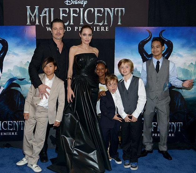 The couple with their kids, minus Vivienne, at the