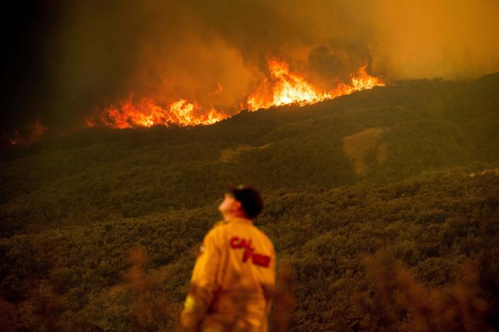 Battalion Chief Matt Sully directs operations on the Ranch fire, part of the Mendocino Complex fire, burning near Clearlake Oaks on Sunday. (Photo: NOAH BERGER via Getty Images)