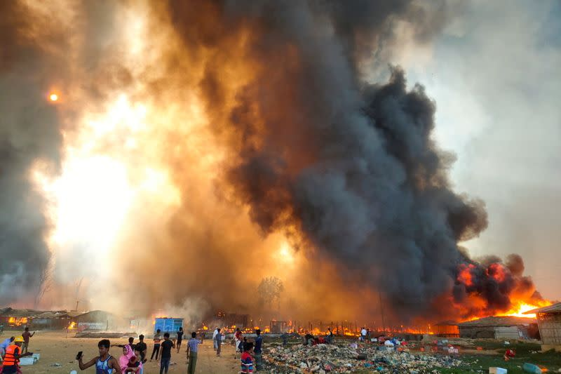 Smoke billows at the site of the Rohingya refugee camp where fire broke out in Cox's Bazar