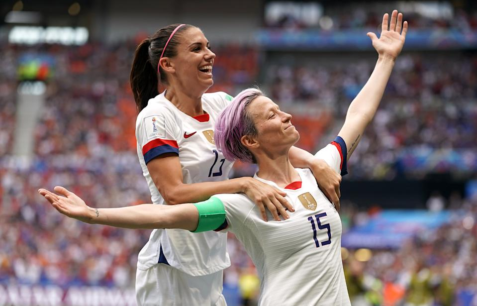 USA's Megan Rapinoe (right) celebrates scoring her side's first goal of the game from the penalty spot with team-mate Alex Morgan (top) USA v Netherlands - FIFA Women's World Cup 2019 - Final - Stade de Lyon 07-07-2019 . (Photo by  John Walton/EMPICS/PA Images via Getty Images)