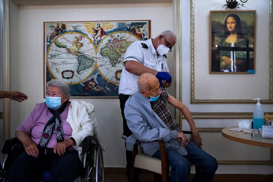 A man receives his second Pfizer vaccine at a nursing home in Ramat Gan. All over 60s will soon be offered a third vaccine. (AP)