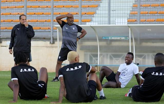 Saint-Pierroise coach Christian Dafreville (standing, C) talks to his players during training ahead of their French Cup tie against Epinal -- they are the first team from a French overseas territory to reach this stage since 1989 (AFP Photo/Richard BOUHET)