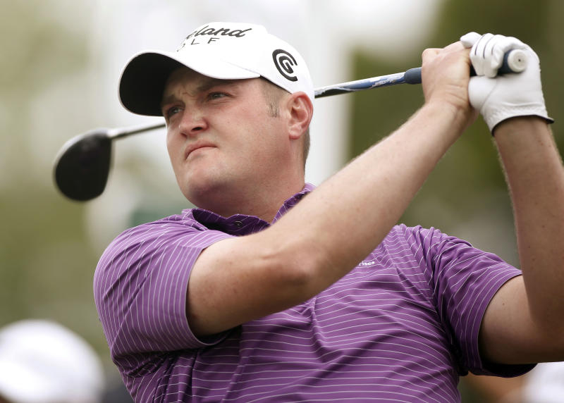 Jason Kokrak watches his shot on the tenth hole during the second round of the Houston Open golf tournament on Friday, March 29, 2013, in Humble, Texas. (AP Photo/Jon Eilts)
