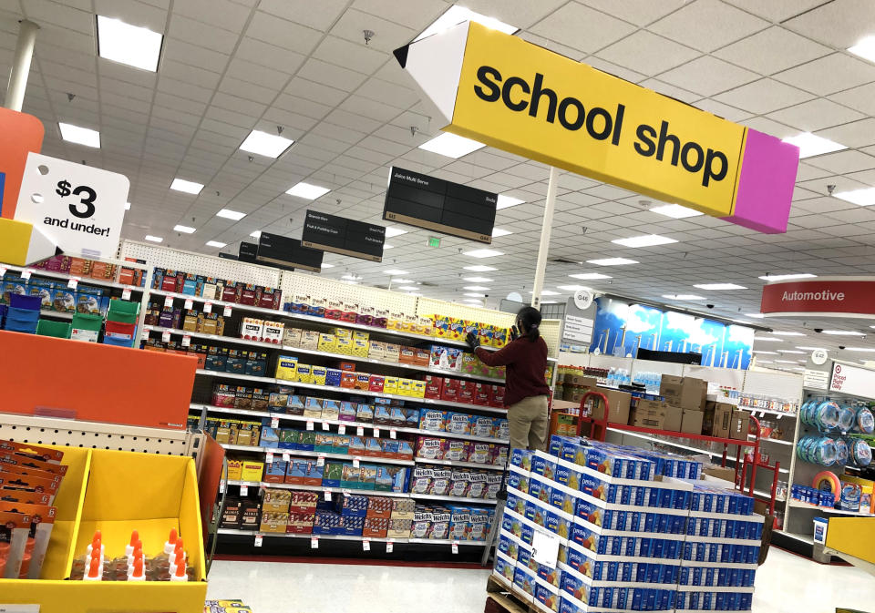 A worker stocks shelves of back-to-school supplies at a Target store in Colma, Calif. (Photo: Getty)