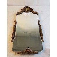 """<h2>Goodwill</h2>The iconic nonprofit thrift shop operates on a bidding-basis online, and while it's much more bric-a-brac heavy you can still uncover some great statement furniture and decor. <br><br> Vintage Framed Mirror, $, available at <a href=""""https://go.skimresources.com/?id=30283X879131&url=https%3A%2F%2Fwww.shopgoodwill.com%2FItem%2F105121476"""" rel=""""nofollow noopener"""" target=""""_blank"""" data-ylk=""""slk:Goodwill"""" class=""""link rapid-noclick-resp"""">Goodwill</a>"""