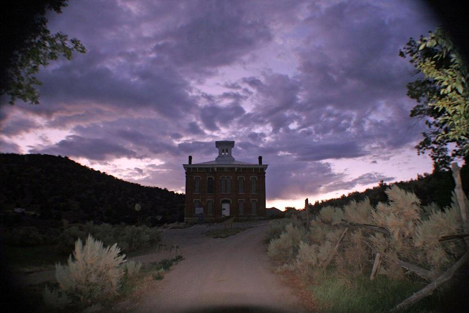 """<p><strong>The Belmont Courthouse - Manhattan, NV</strong></p><p>Far from the hustle and bustle of the Vegas Strip, in Nye County's Humboldt-Toiyable National Forest, lies a small ghost town. Populated with a courthouse, newspaper office, saloon, and mill, the eerie and deserted structures have markings such as <a href=""""https://www.flickr.com/photos/glitch_nitch/1075761765/"""" rel=""""nofollow noopener"""" target=""""_blank"""" data-ylk=""""slk:this"""" class=""""link rapid-noclick-resp"""">this</a> inside of them.<br></p><p>Photo: Flickr/<a href=""""https://www.flickr.com/photos/glitch_nitch/1056636711/in/photolist-nYqPRQ-gHSfgW-2Bnxhk-2h1CKjP-dvxd4g-dvCGY3-dvCJNE-dvwP1i"""" rel=""""nofollow noopener"""" target=""""_blank"""" data-ylk=""""slk:NessieNoodle"""" class=""""link rapid-noclick-resp"""">NessieNoodle</a></p>"""