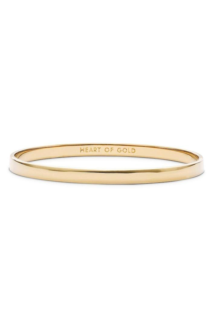 """<p><strong>KATE SPADE NEW YORK</strong></p><p>nordstrom.com</p><p><strong>$26.60</strong></p><p><a href=""""https://go.redirectingat.com?id=74968X1596630&url=https%3A%2F%2Fwww.nordstrom.com%2Fs%2Fkate-spade-new-york-idiom-heart-of-gold-bangle%2F3299865&sref=https%3A%2F%2Fwww.womansday.com%2Flife%2Fg36267034%2Fmothers-day-gift-ideas%2F"""" rel=""""nofollow noopener"""" target=""""_blank"""" data-ylk=""""slk:Shop Now"""" class=""""link rapid-noclick-resp"""">Shop Now</a></p><p>A little something to let Mom or your mother-in-law know just how kind and loving she's been to you over the years. </p>"""
