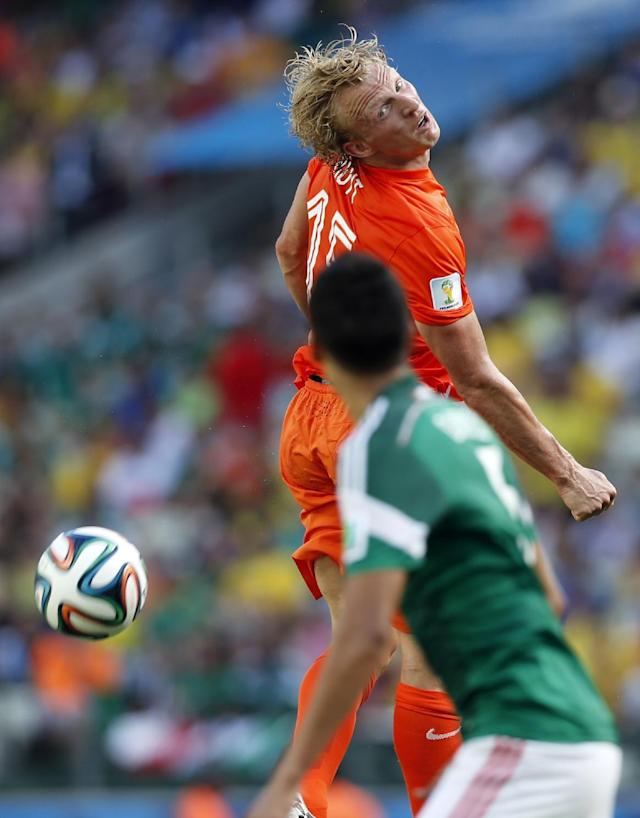 Netherlands' Dirk Kuyt heads the ball during the World Cup round of 16 soccer match between the Netherlands and Mexico at the Arena Castelao in Fortaleza, Brazil, Sunday, June 29, 2014. (AP Photo/Wong Maye-E)