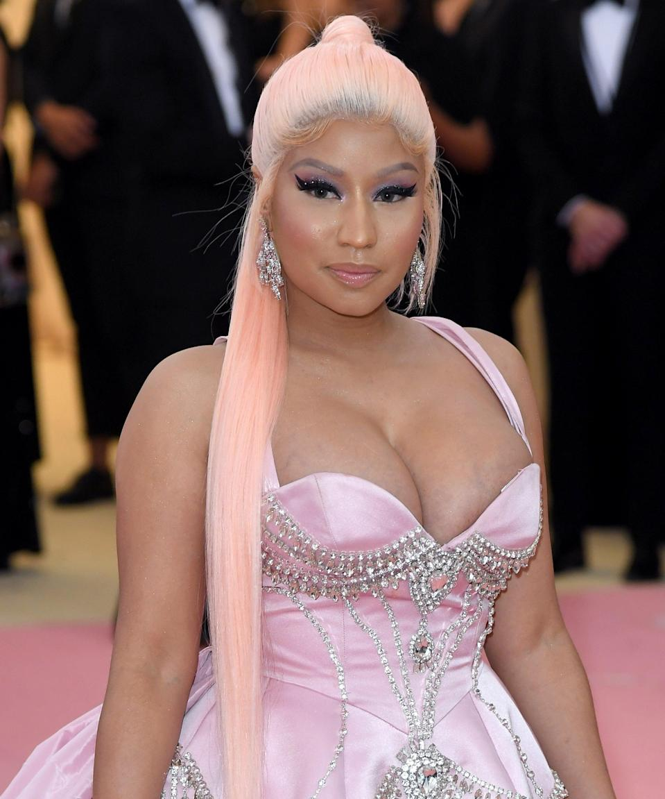 <h3>Nicki Minaj</h3><br>While Nicki Minaj has dabbled in almost every hair color, she's most well know for her Barbie-pink wigs and weaves. Find a ponytail clip-in to channel the rapper at last year's Met Gala.