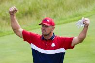 Team USA's Bryson DeChambeau reacts to the crowd on the first tee during a Ryder Cup singles match at the Whistling Straits Golf Course Sunday, Sept. 26, 2021, in Sheboygan, Wis. (AP Photo/Ashley Landis)