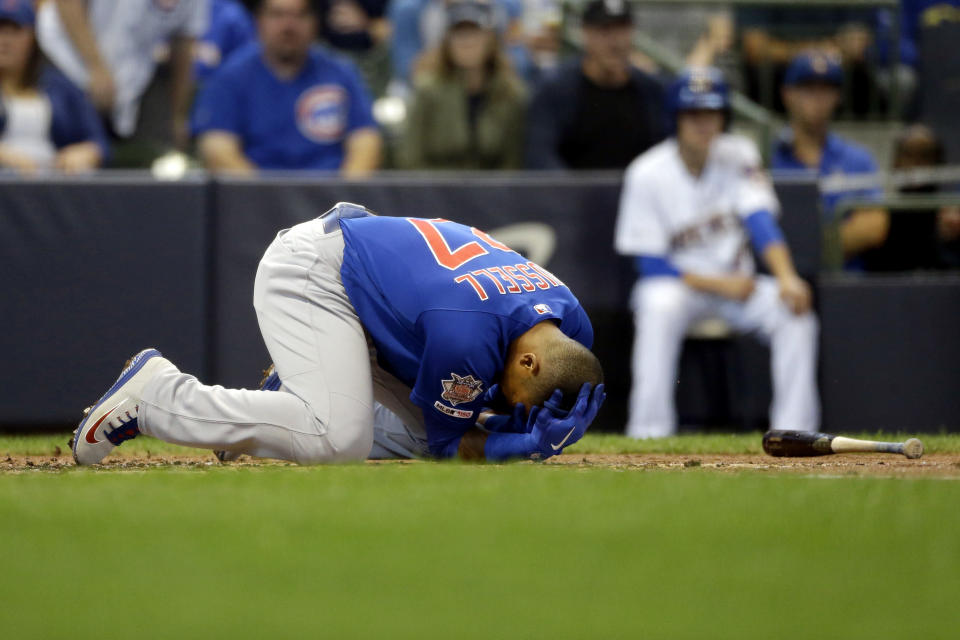 Chicago Cubs' Addison Russell falls to the ground after being hit by a pitch during the third inning of a baseball game against the Milwaukee Brewers, Sunday, Sept. 8, 2019, in Milwaukee. (AP Photo/Aaron Gash)