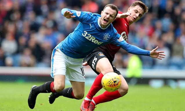 Rangers' Andy Halliday is challenged by Kilmarnock's Eamonn Brophy during the Scottish Premiership match.
