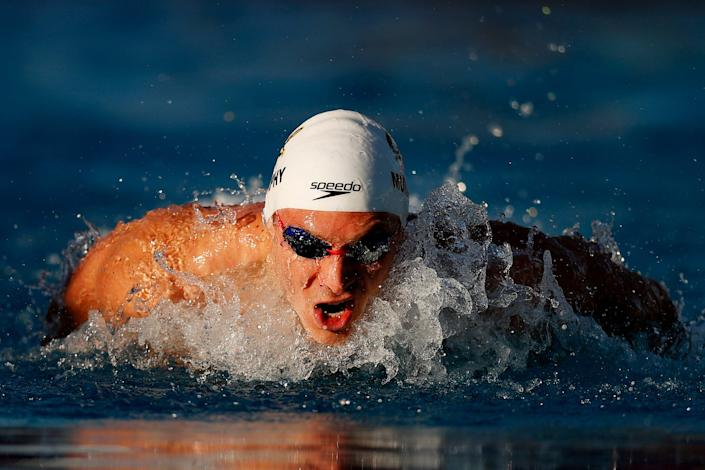 Ryan Murphy competes in the men's 100-meter butterfly heats during the TYR Pro Swim Series at Mission Viejo at Marguerite Aquatics Center on April 8, 2021 in Mission Viejo, California.