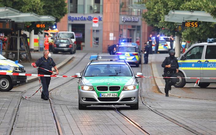 A street is cordoned off and lined with police cars - Karl-Josef Hildenbrand/dpa
