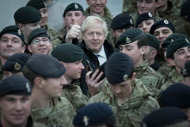 Prime Minister Boris Johnson addresses British soldiers after serving Christmas lunch to British troops stationed in Estonia during a one-day visit to the Baltic country (Stefan Rousseau/PA)