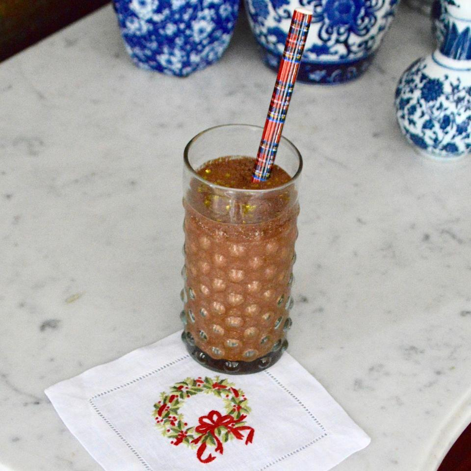 "<p>""I first tried hot chocolate and amaretto together with my dad on a cold afternoon in Alaska. Both the memory and the ingredient combination warm me up."" -Stephanie Nass, NYC-based caterer and founder of <a href=""https://chefanie.com/"" rel=""nofollow noopener"" target=""_blank"" data-ylk=""slk:Chefanie"" class=""link rapid-noclick-resp"">Chefanie</a><br></p><p><strong>Chefanie's Amaretto Hot Cocoa Recipe</strong></p><p><strong>Ingredients:</strong></p><p>1 cup milk </p><p> 1/4 cup cocoa powder </p><p> 2 teaspoons sugar</p><p>1 tablespoon Amaretto </p><p>Gold leaf flakes</p><p><strong>Directions: </strong></p><p>Whisk together milk, cocoa powder, and sugar in a saucepan over low heat until warm. Mix in Amaretto and garnish with gold leaf flakes. </p>"