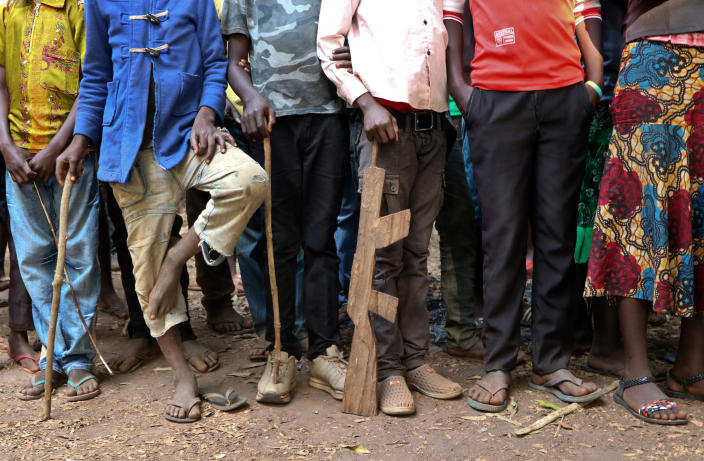 FILE - In this Wednesday, Feb. 7, 2018 file photo, former child soldiers stand in line waiting to be registered with UNICEF to receive a release package, in Yambio, South Sudan. A new report made public in Nov. 2019 says South Sudan's National Security Service has recruited a force of 10,000 fighters in President Salva Kiir's ethnic stronghold, in apparent breach of the terms of the country's peace deal. (AP Photo/Sam Mednick, File)