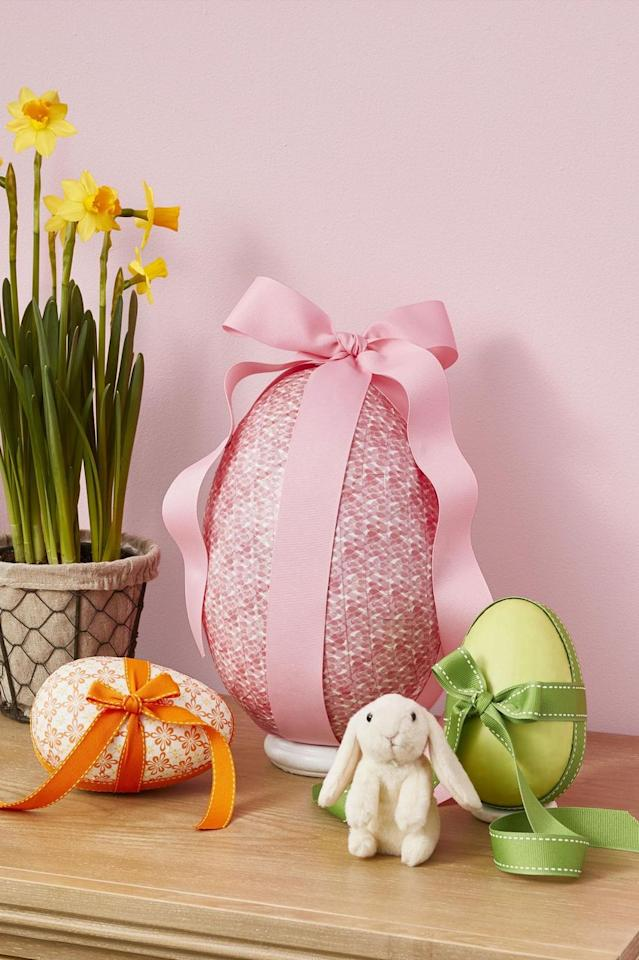 "<p>Craft this giant egg and then fill it with surprises like candy and toys to <em>really</em> impress the kids this year.<strong><a href=""https://www.womansday.com/home/crafts-projects/g2216/easter-eggs/?slide=2"" target=""_blank""><em></em></a></strong></p><p><strong><a href=""https://www.womansday.com/home/crafts-projects/g2216/easter-eggs/?slide=2"" target=""_blank"">Get the tutorial.</a></strong></p><p><strong><strong>What you'll need</strong>: </strong>Cake stand ($27, <a href=""https://www.amazon.com/VILAVITA-Cupcake-Dessert-Birthday-Celebration/dp/B074TF6YB4"" target=""_blank"">amazon.com</a>)<br></p>"