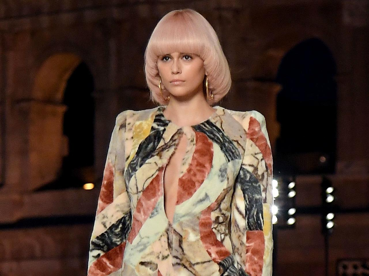 """<p>The model wore a pastel bowl cut bob wig on the Fendi Haute Couture Fall 2019 runway in Rome. """"The look was inspired by the geometric bobs of the late '60s and '70s that Karl [Lagerfeld, the late designer of Fendi] featured in his illustrations at that time,"""" said hairstylist Sam McKnight in the September 2019 issue of <em>InStyle</em>. """"I cut many variations, and this round shape is so attering; it opens up the face."""" He set the very chic bobs with a mist of <a href=""""https://click.linksynergy.com/deeplink?id=93xLBvPhAeE&mid=24449&murl=https%3A%2F%2Fwww.net-a-porter.com%2Fus%2Fen%2Fproduct%2F998865%2FHAIR_BY_SAM_McKNIGHT_%2Fmodern-hairspray-250ml&u1=IS%2CBowlCuts-Embed-2%2Ckchiello1271%2C%2CIMA%2C3476219%2C201909%2CI"""" target=""""_blank"""">hairspray</a> from his eponymous haircare line. </p>"""