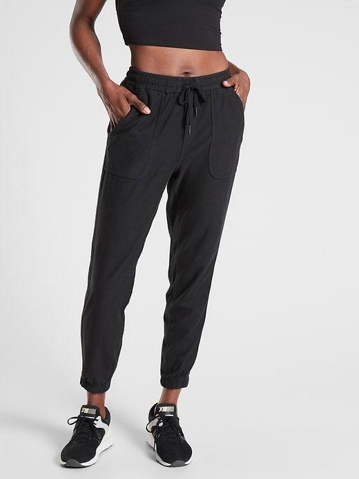 """<p><strong>Athleta</strong></p><p>athleta.gap.com</p><p><strong>$98.00</strong></p><p><a href=""""https://go.redirectingat.com?id=74968X1596630&url=https%3A%2F%2Fathleta.gap.com%2Fbrowse%2Fproduct.do%3Fpid%3D531090002%26cid%3D1084161%26pcid%3D46813%26vid%3D2%26grid%3Dpds_9_179_1%23pdp-page-content&sref=https%3A%2F%2Fwww.womenshealthmag.com%2Ffitness%2Fg36719192%2Fbest-joggers-for-women%2F"""" rel=""""nofollow noopener"""" target=""""_blank"""" data-ylk=""""slk:Shop Now"""" class=""""link rapid-noclick-resp"""">Shop Now</a></p><p>Leave it to fitness and wellness editor, Lauren Del Turco (she's ACE certified, too!), to know what's good in the performance-ready jogger department. """"I pretty much live in these joggers,"""" she says. """"They're cute enough that I feel like I can wear them out and about without looking like I'm in PJs but are also so stretchy and soft that I lounge in them, too. The material is also super breathable, so I can go for a walk or run errands on my bike without feeling too sweaty.""""</p>"""