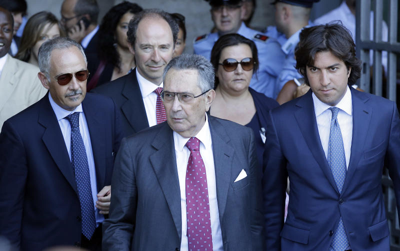 Silvio Berlusconi's lawyer Franco Coppi, center, leaves the Court of Cassation building where Berlusconi's case on tax fraud will be decided, in Rome, Tuesday, July 30, 2013. Berlusconi's political fate is in the hands of Italy's highest court, which is preparing to hear arguments in the former premier's fraud conviction. Berlusconi has been convicted of tax fraud in a complex TV rights transaction for his Mediaset network, and sentenced to four-years in prison with a five-year ban on public office. This is his final appeal. (AP Photo/Gregorio Borgia)