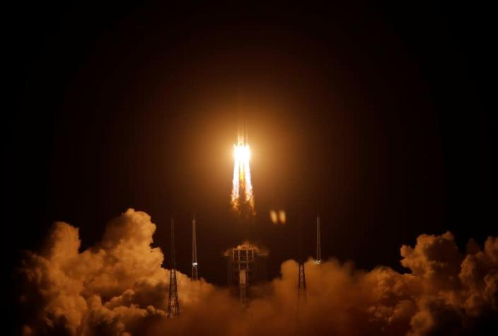 The Long March-5 Y5 rocket, carrying the Chang'e-5 lunar probe, takes off from Wenchang Space Launch Center, in Wenchang