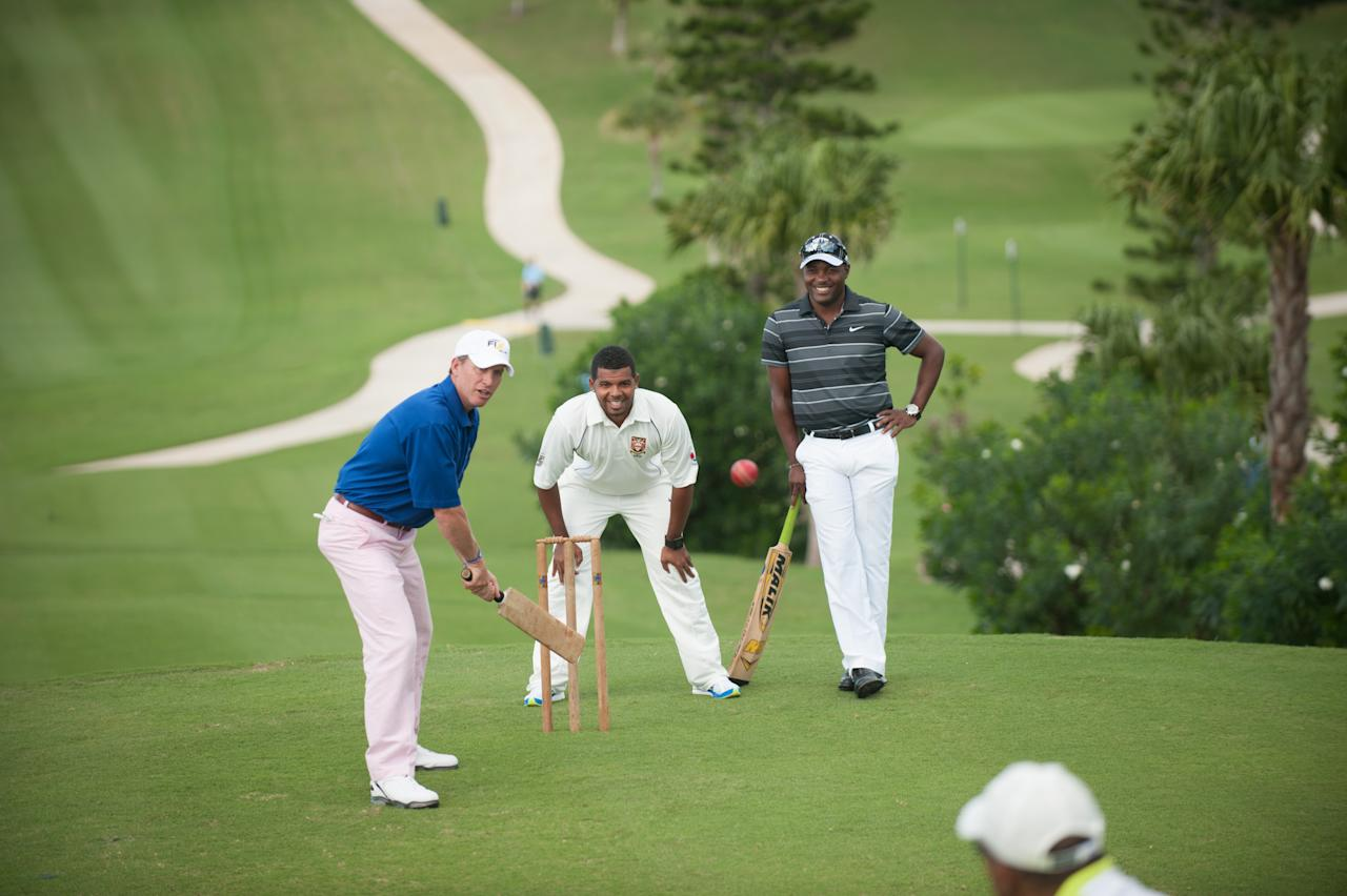 SOUTHAMPTON, BERMUDA - OCTOBER 22: Golf Channel's Michael Breed (L) plays cricket with legend Brian Lara (R) during the Grand Slam Pro Am at The Port Royal Golf Club for the 30th Grand Slam of Golf on October 22, 2012 in Southampton, Bermuda. (Photo by Rochalle Stewart/The PGA of America via Getty Images)