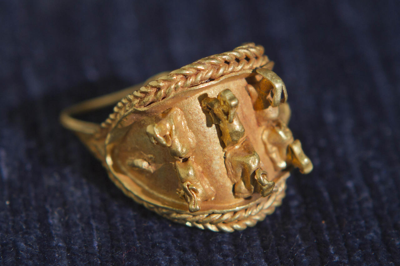In this photo taken Wednesday, May 23, 2012 an ancient jewel discovered by Israeli archaeologists is displayed at the Tel Aviv University, Israel. Israeli archaeologists have unearthed a stash of rare ancient jewelry near the site of the biblical Armageddon in the north of the country. Israel Finkelstein of Tel Aviv University, who co-directed the dig, said this week that the find offers a rare glimpse into ancient Canaanite high society. The 3,000-year-old jewelry was found inside a ceramic vessel, suggesting the owner hid them before fleeing, he said. (AP Photo/Dan Balilty)