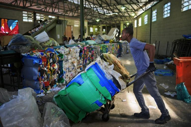 A men works in the recycling of plastic bags at CoopFuturo, a sorting collective which receives rubbish from the local government collection service and then sells the material to specialized recycling companies, in Rio de Janeiro, Brazil