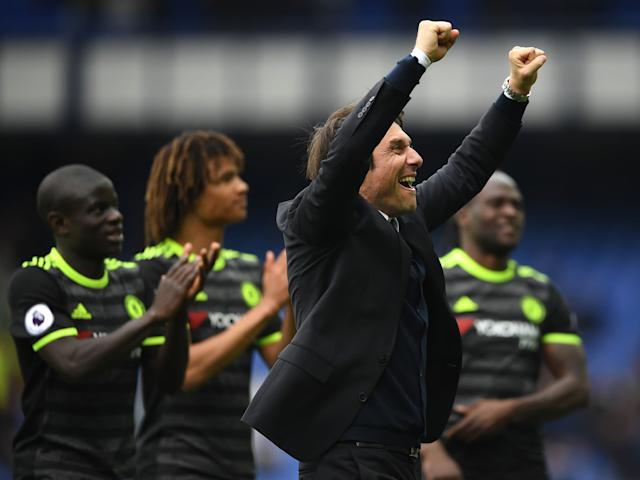 Conte celebrates with his players after Chelsea's recent win over Everton: Getty