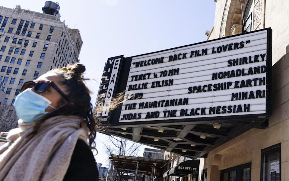 A sign with a welcome message for moviegoers on the Village East movie theatre in New York on Friday - JUSTIN LANE/EPA-EFE/Shutterstock