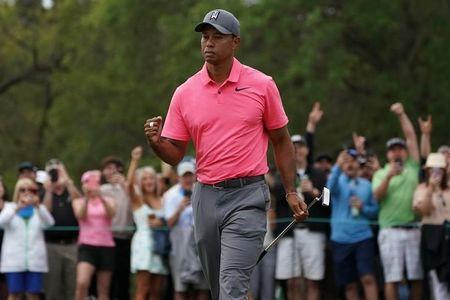 Mar 10, 2018; Palm Harbor, FL, USA; Tiger Woods pumps his fist after making a birdie putt on the 10th during the third round of the Valspar Championship golf tournament at Innisbrook Resort - Copperhead Course. Mandatory Credit: Jasen Vinlove-USA TODAY Sports