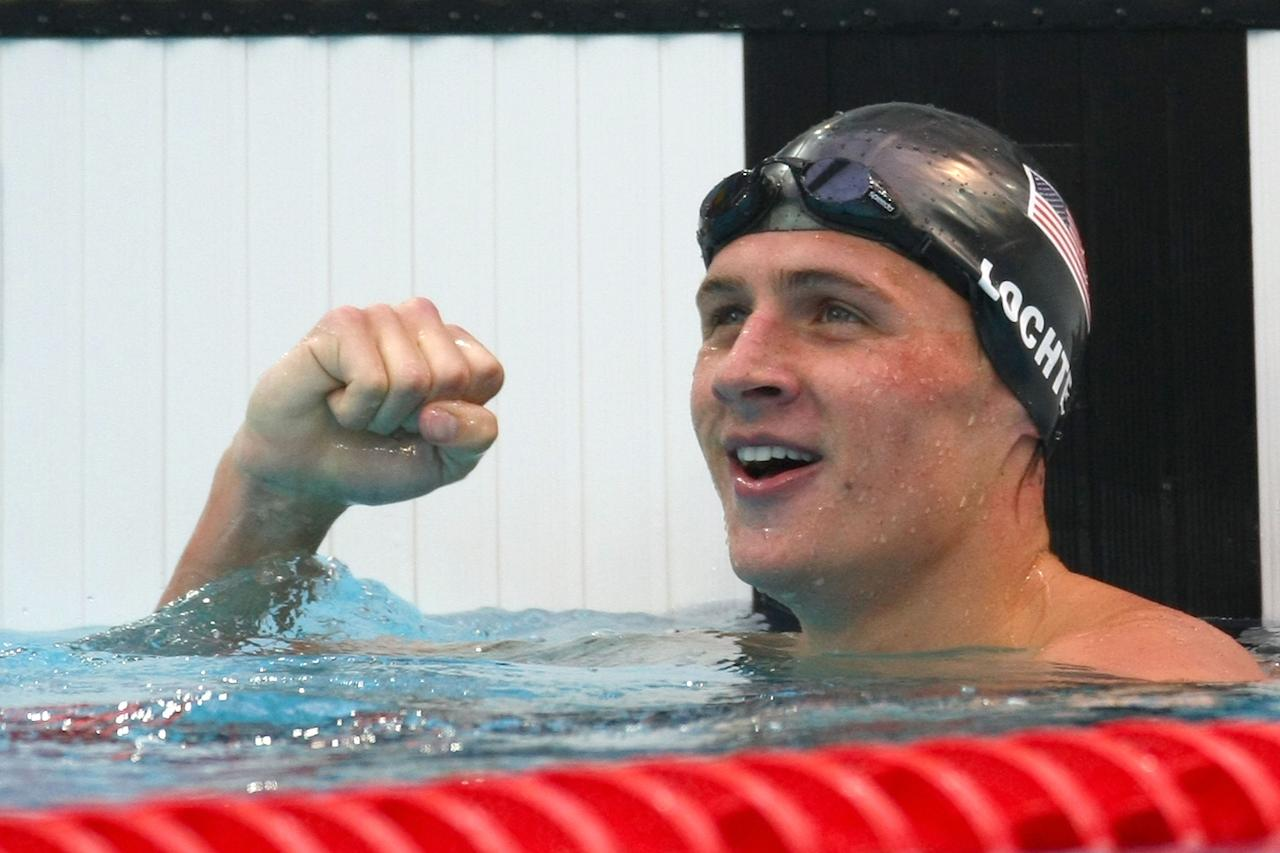 Ryan Lochte of the United States celebrates victory after the Men's 200m Backstroke Final at the National Aquatics Center on Day 7 of the Beijing 2008 Olympic Games on August 15, 2008 in Beijing, China. Lochte won in a new world record time of 1:53.94