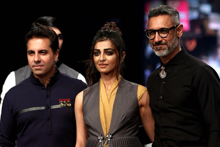 Radhika Apte (C) showcases a creation by designers Shantanu (L) and Nikhil (R) at the Van Heusen GQ Fashion Nights 2017 in Mumbai on November 11, 2017. (Photo by STR/AFP/Getty Images)