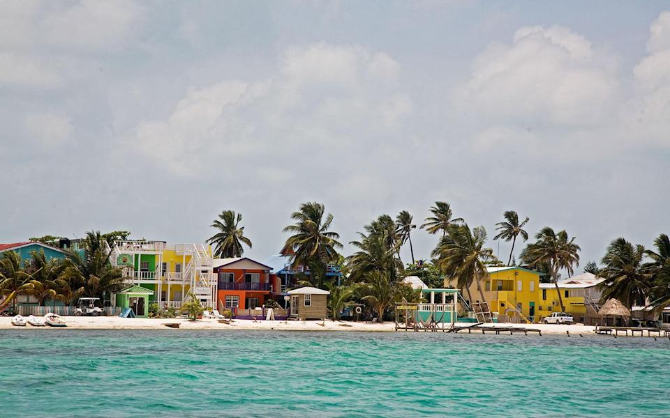 """<p>There's nary a traffic light on this laid-back island-a five-mile strip of land that's a 15-minute flight from Belize's main airport. Head to Shark Ray Alley to snorkel among nurse sharks and stingrays or go scuba diving at the underwater caves of Blue Hole. Aboveground, try the curried lobster at the roadside <strong>Jolly Roger's Grill</strong> <em>(Ave. Hicaco; 011-501/664-3382; dinner for two $25)</em>. On the eastern side of the Caye, <strong>Seaside Cabanas</strong> <em>(501/226-0498; <a href=""""http://www.seasidecabanas.com/"""" rel=""""nofollow noopener"""" target=""""_blank"""" data-ylk=""""slk:seasidecabanas.com"""" class=""""link rapid-noclick-resp"""">seasidecabanas.com</a>; doubles from $105)</em> has 10 rooms and six colorful cabins, each with its own roof terrace for taking in those amazing Caribbean views.</p><p><strong>T+L Tip:</strong> Visit during the annual <strong>Lobster Festival</strong> <em>(July 13),</em> when the main road turns into a street party. -<em>Josh Krist</em></p>"""
