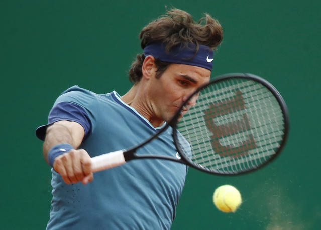Roger Federer of Switzerland, returns the ball to Radek Stepanek Czech Republic during their match at the Monte Carlo Tennis Masters tournament in Monaco, Wednesday, April 16, 2014. (AP Photo/Michel Euler)