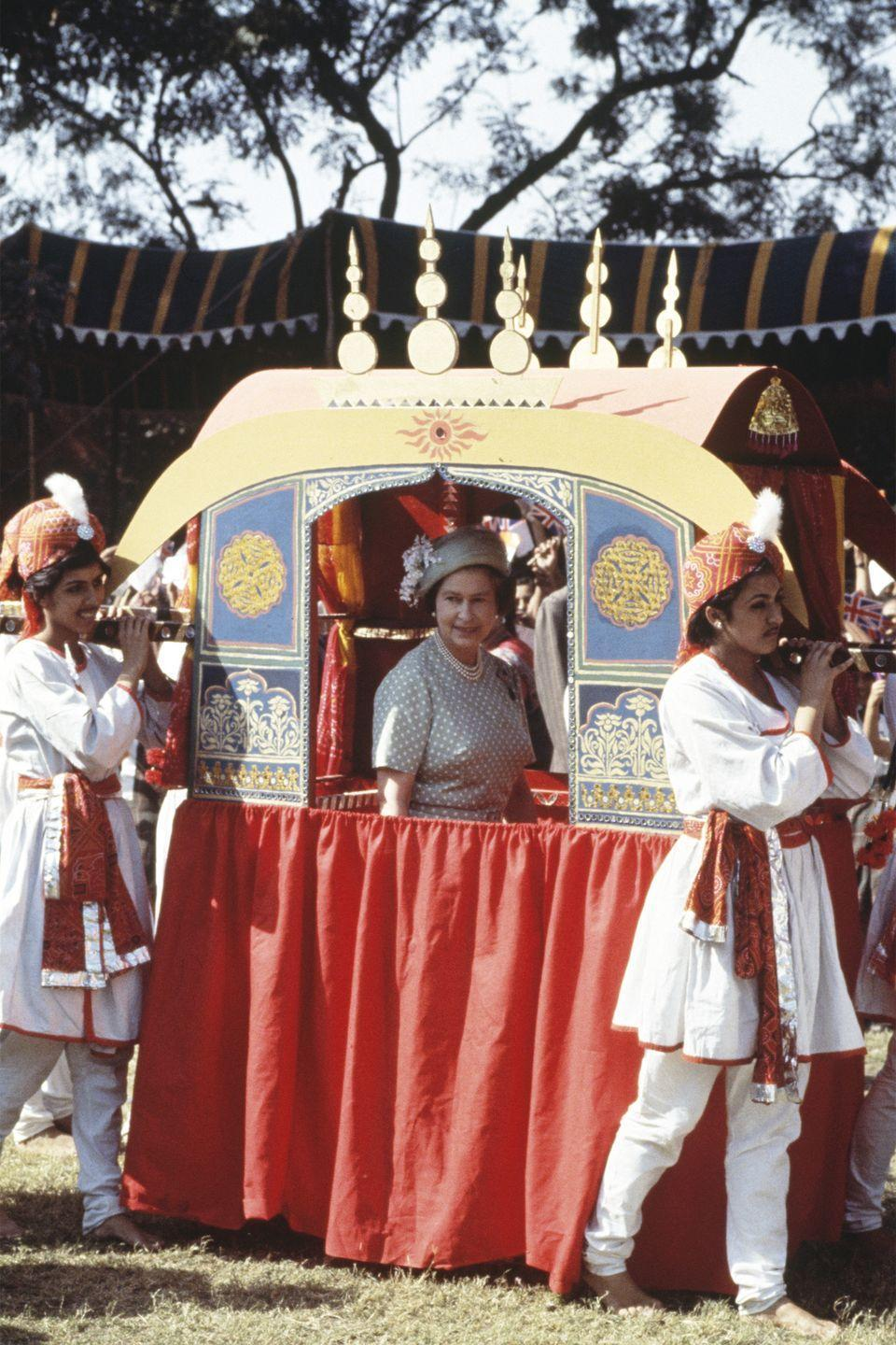 <p>At the time of her royal visit to Delhi, India, Elizabeth rode in a traditional Indian palki, which is usually a carriage lifted by groomsmen and brings the bride to her husband.<br></p>