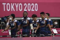 Japan players leave the pitch after their men's rugby sevens match against Britain at the 2020 Summer Olympics, Monday, July 26, 2021 in Tokyo, Japan. (AP Photo/Shuji Kajiyama)