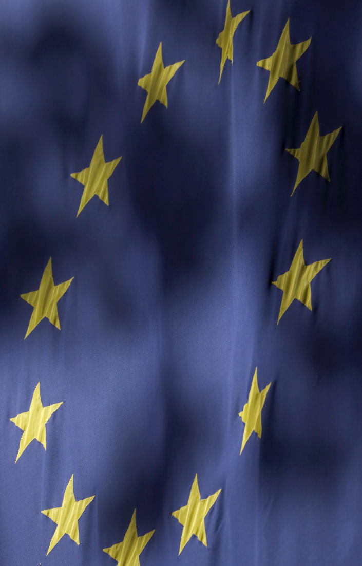 The stars of the EU flag are seen at the Europa House in London, Monday, Oct. 19, 2020. According to media reports, European Commission vice president Maros Sefcovic has met Chancellor of the Duchy of Lancaster Michael Gove for talks on the EU-UK trade deal. (AP Photo/Frank Augstein)