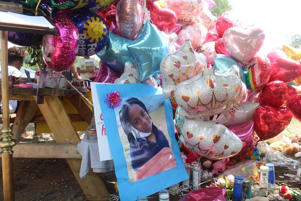 Family, friends and many others turned a picnic table into a memorial for Loyalti Allah, a 13-year-old who was fatally shot in a drive-by shooting on Icemorelee Street in Monroe, NC, on Saturday, July 24, 2021.