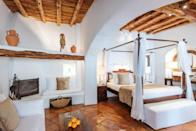 """<p>Tucked away among the fragrant orange and olive groves of San Lorenzo and near Santa Eularia, this exquisite boutique spa hotel housed in a 300-year old finca is all about living the Ibiza dream. Set in 10 acres of beautifully manicured gardens laced with palm trees and bougainvillea-draped pavilions, what <a href=""""https://www.booking.com/hotel/es/atzaro.en-gb.html?aid=2070929&label=ibiza-hotels"""" rel=""""nofollow noopener"""" target=""""_blank"""" data-ylk=""""slk:Atzaro"""" class=""""link rapid-noclick-resp"""">Atzaro</a> lacks in sea views it makes up for in natural ambiance. Not to mention the softly scented, muslin-draped rooms and a spectacular open-air spa with a sauna, hammam and yoga pavilion. </p><p>After a night on the tiles, enjoy a late and lazy breakfast on the terrace of La Veranda, or stay for a relaxed dinner at The Orange Tree courtyard restaurant. And if you crave the beach life, Atzaro guests have first dibs at the Balinese beds at the finca's funky beach club in Cala Nova.</p><p><a class=""""link rapid-noclick-resp"""" href=""""https://www.booking.com/hotel/es/atzaro.en-gb.html?aid=2070929&label=ibiza-hotels"""" rel=""""nofollow noopener"""" target=""""_blank"""" data-ylk=""""slk:CHECK AVAILABILITY"""">CHECK AVAILABILITY</a></p>"""