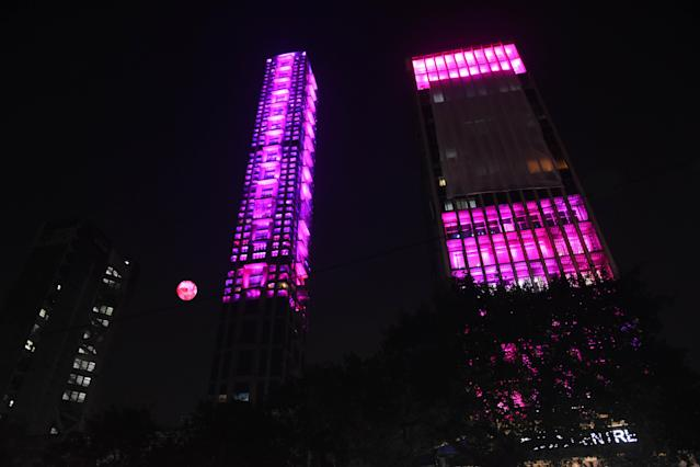 The tallest building 42 and Tata Center Pink illuminated on November 21,2019 in Kolkata,India. a historic venue, getting ready to host Indias first Day-Night Pink Ball Test from November 22. Indias opponent is Bangladesh and the haze seems to denote the mists of time through which Kolkatas prized playing field has come with credit, being witness to many a humdinger across formats. (Photo by Debajyoti Chakraborty/NurPhoto via Getty Images)